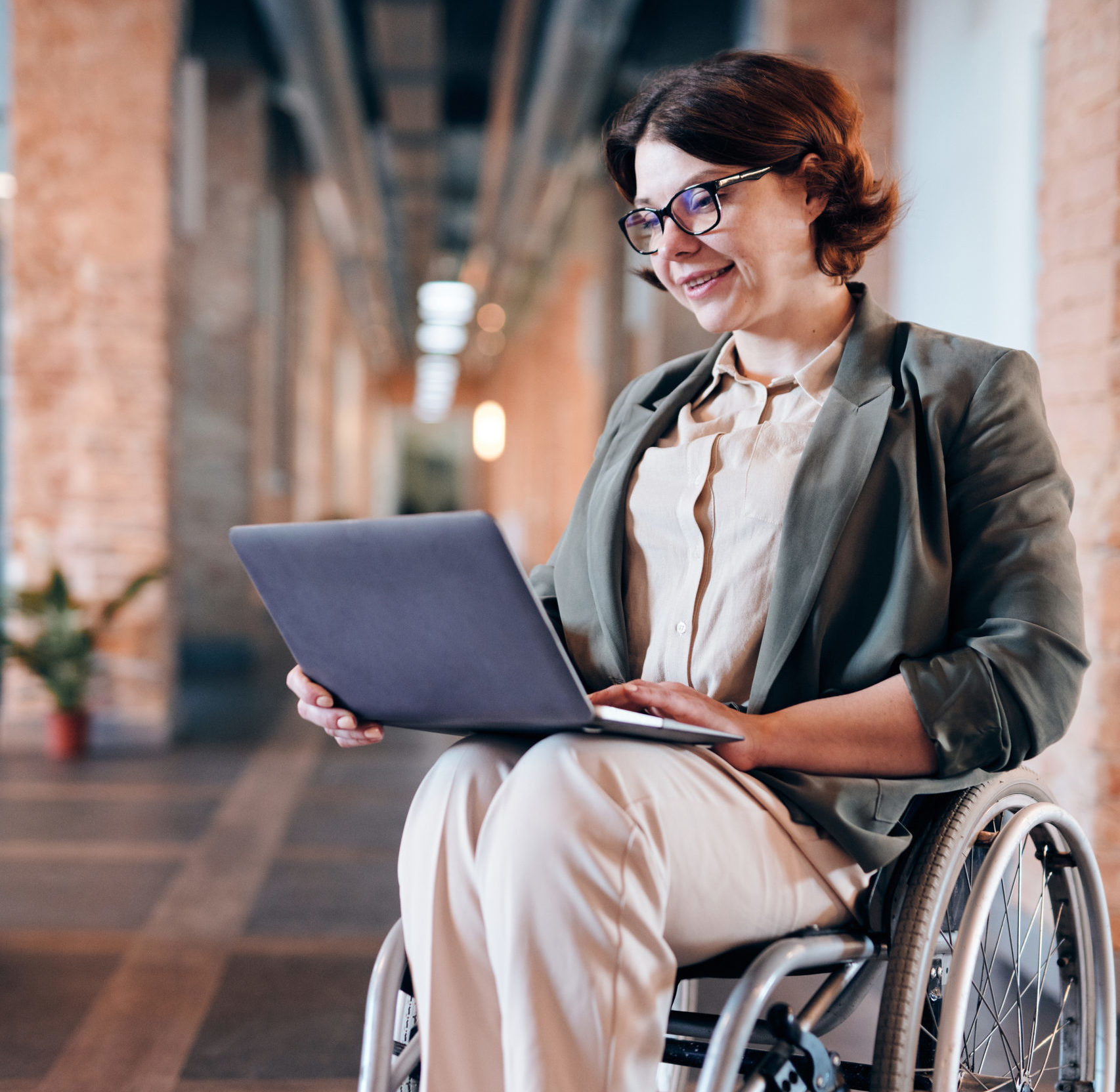 photo-of-woman-sitting-on-wheelchair-while-using-laptop-4064417